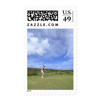 Woman playing golf stamps