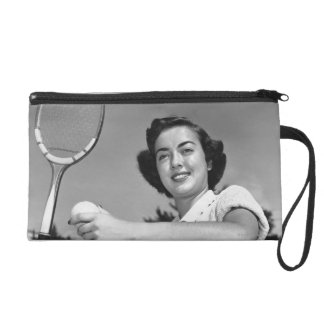 Woman Playing Tennis 3 Wristlet Clutches