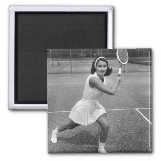 Woman playing tennis magnet