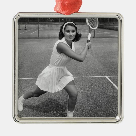 Woman playing tennis metal ornament