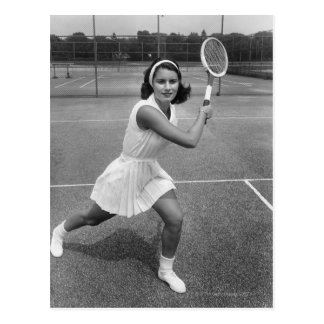 Woman playing tennis postcard