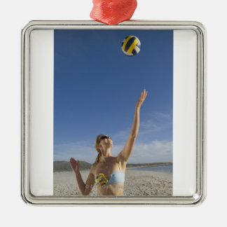 Woman playing volleyball on beach christmas tree ornaments