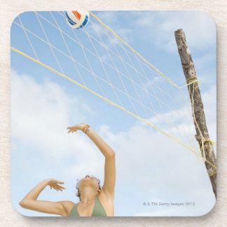 Woman playing volleyball outdoors beverage coaster