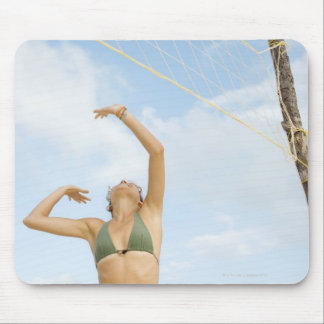 Woman playing volleyball outdoors mouse pad