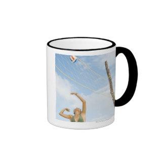 Woman playing volleyball outdoors ringer mug