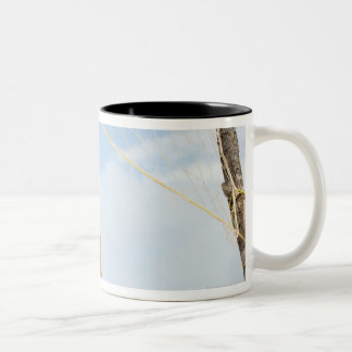 Woman playing volleyball outdoors Two-Tone coffee mug