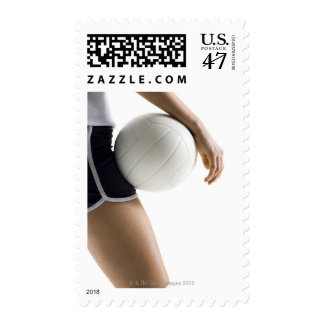 woman playing volleyball postage