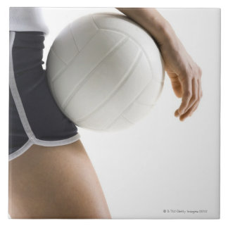 woman playing volleyball tile