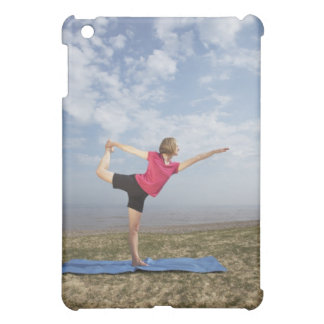 Woman practicing yoga by the beach case for the iPad mini