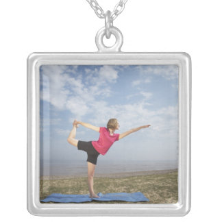 Woman practicing yoga by the beach square pendant necklace