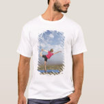 Woman practicing yoga by the beach T-Shirt