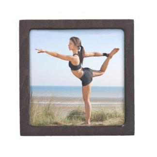 Woman practicing yoga on beach keepsake box