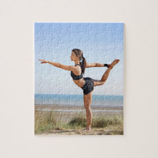 Woman practicing yoga on beach puzzle