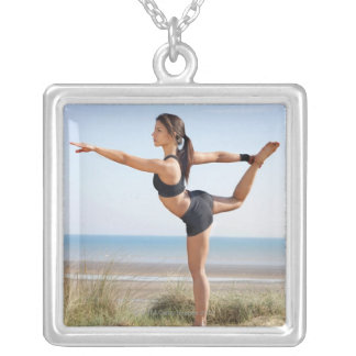 Woman practicing yoga on beach square pendant necklace