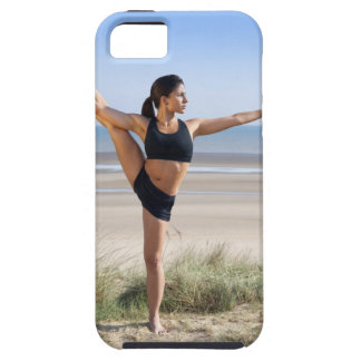 woman practicing yoga on beach wearing iPhone 5 cover