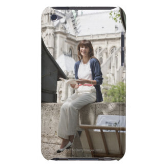 Woman reading a book at a book stall, Notre Dame iPod Touch Case