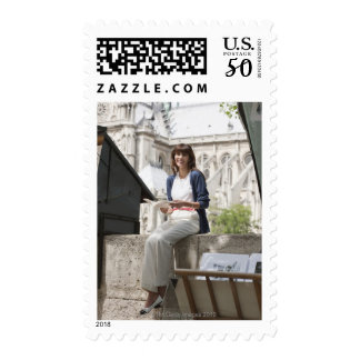 Woman reading a book at a book stall, Notre Dame Postage