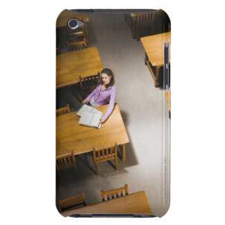 Woman reading book in library barely there iPod case