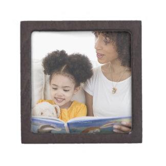 Woman reading book with daughter keepsake box