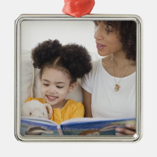 Woman reading book with daughter metal ornament