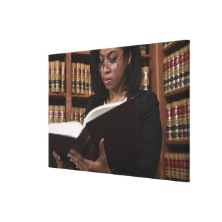 Woman reading in law library canvas print