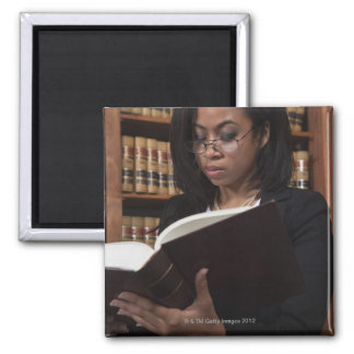 Woman reading in law library magnet