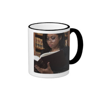 Woman reading in law library coffee mug