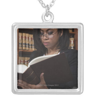 Woman reading in law library necklace