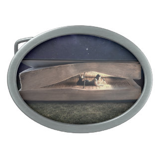Woman Reading Inside Book at Night Oval Belt Buckle