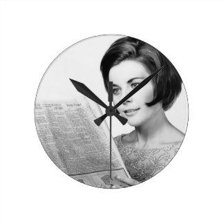 Woman Reading Newpaper Round Wall Clock