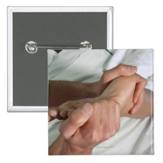 Woman receiving foot massage 2 2 inch square button