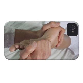 Woman receiving foot massage 2 iPhone 4 case