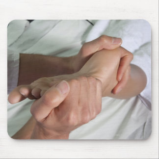 Woman receiving foot massage 2 mouse pads