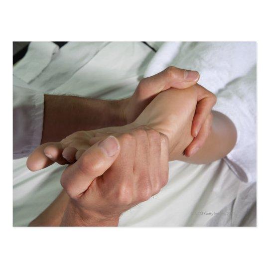 Woman receiving foot massage 2 postcard