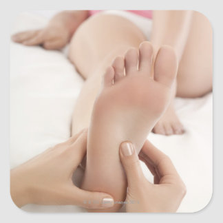 Woman Receiving Foot Massage Square Sticker