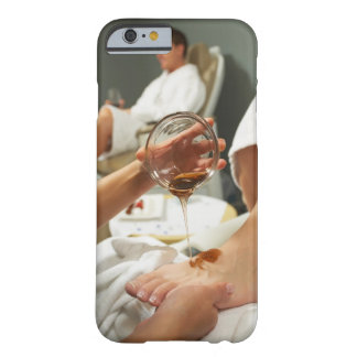 Woman receiving foot massage with oil barely there iPhone 6 case
