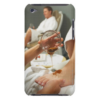 Woman receiving foot massage with oil barely there iPod cover