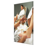 Woman receiving foot massage with oil canvas print