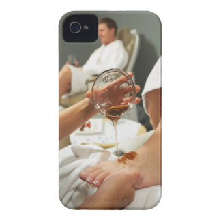 Woman receiving foot massage with oil iPhone 4 cover