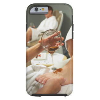 Woman receiving foot massage with oil tough iPhone 6 case