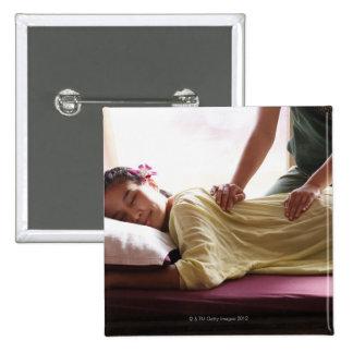 Woman receiving massage #1 pinback button