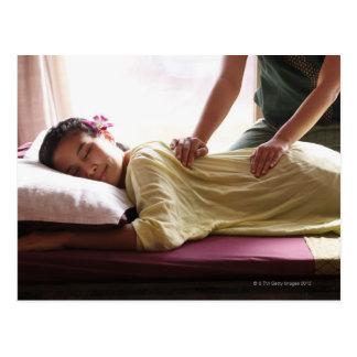 Woman receiving massage #1 postcard