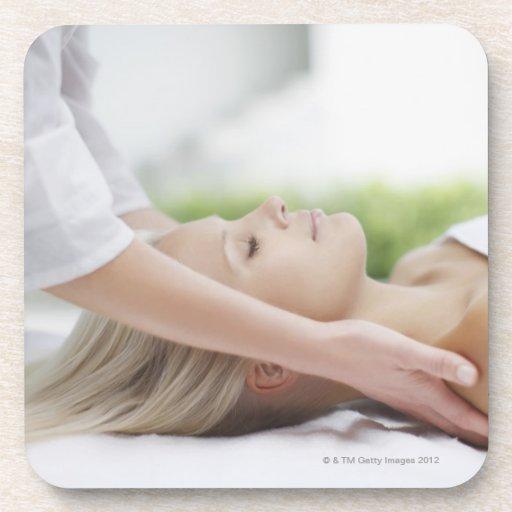 Woman receiving massage beverage coasters