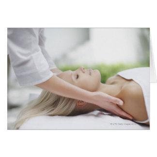 Woman receiving massage card