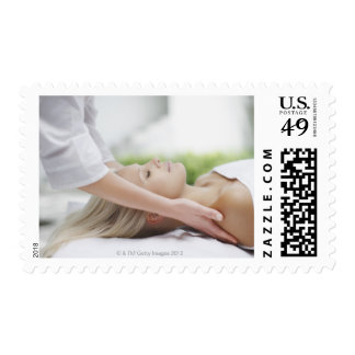Woman receiving massage stamps