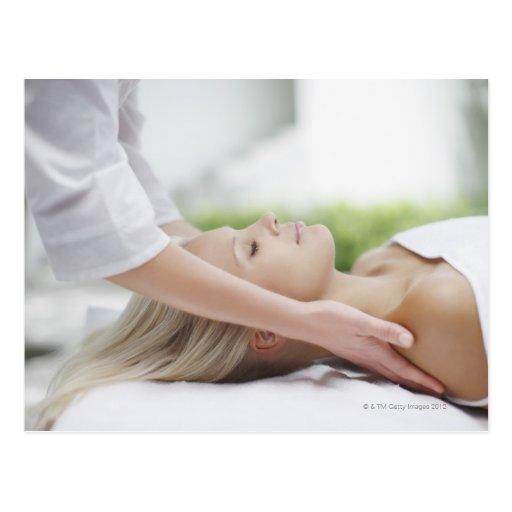 Woman receiving massage postcard