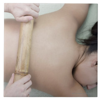 Woman receiving spa treatment ceramic tile