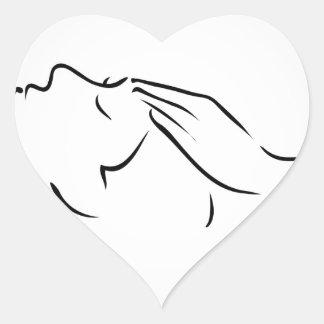 Woman receiving spa treatment heart sticker
