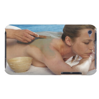 Woman receiving spa treatment, side view, close iPod Case-Mate case