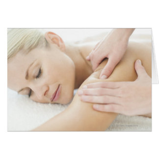 Woman relaxing at a spa while receiving a 2 card